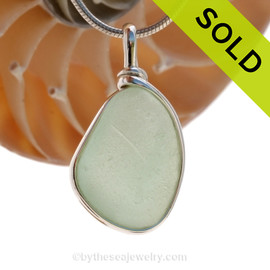 A neat triangular seafoam green natural sea glass in my Original Sterling Wire Bezel© a simple design that lets all the beauty of this glass shine.  SOLD - Sorry this Sea Glass Pendant is NO LONGER AVAILABLE!