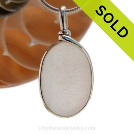 A larger and longer piece of antique English Sea Glass in pure white in a solid sterling silver pendant in our Original Wire Bezel© setting. SOLD - Sorry this Rare Sea Glass Pendant is NO LONGER AVAILABLE!