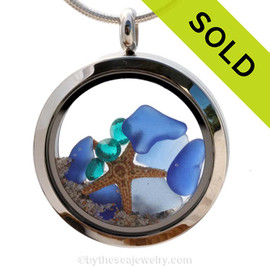 Beautiful pieces of natural Cobalt Blue & Light Blue sea glass combined in a stainless steel locket necklace with a real starfish & Zircon crystal Gems. Sorry this Sea Glass Jewelry piece has been SOLD!