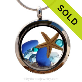 Beautiful pieces of natural Cobalt Blue sea glass combined in a stainless steel locket necklace with a real starfish & Zircon & Turquoise crystal Gems. Sorry this sea glass locket has been sold!