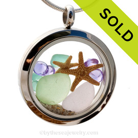 Stunning early 20th century purple, seafoam and aqua sea glass combined with beach sand and brightened up with amethyst gems makes this a great choice for a February Birthday.