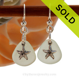 Natural pale seafoam green sea glass earrings are set with solid sterling  starfish charms and are presented on sterling silver fishook earrings. SOLD - Sorry this Sea Glass Jewelry piece is NO LONGER AVAILABLE