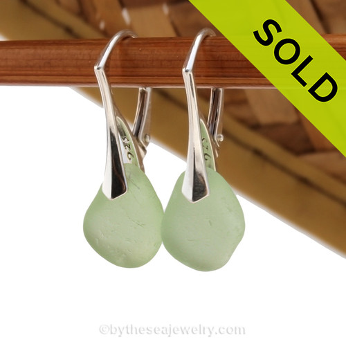 Simple beach found green Sea Glass Earrings on solid sterling silver leverbacks. SOLD - Sorry this Sea Glass Jewelry selection is NO LONGER AVAILABLE.