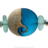 A detail of this Sea Glass Bangle Bracelet shows you the quality of the natural beach found sea glass pieces and the handmade wave bead.