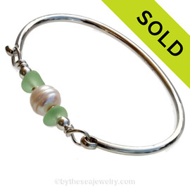 Vivid yellowy seafoam green found sea glass combined with real cultured pearls on this solid sterling silver round sea glass bangle bracelet.  SOLD - Sorry This Sea Glass Bracelet Is NO LONGER AVAILABLE!