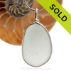 A larger and flatter piece of antique English Sea Glass in pure white in a solid sterling silver pendant in our Original Wire Bezel© setting. SOLD - Sorry this Sea Glass Pendant is NO LONGER AVAILABLE