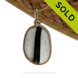 SOLD - Sorry This ULTRA RARE Sea Glass Jewelry Pendant  Is NO LONGER AVAILABLE! An Ultra Rare piece of mixed black and white sea glass set in our Original Wire Bezel© setting in 14K Goldfilled.