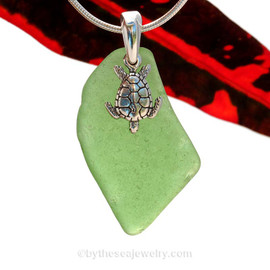 Larger Green sea glass necklace set on a solid sterling cast bail with a sterling silver Turtle charm.