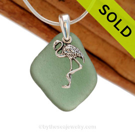 A rarer deep Aqua Green sea glass necklace set on a solid sterling cast bail with a sterling silver tropical Flamingo charm. Sorry this Sea Glass Jewelry piece has been SOLD!