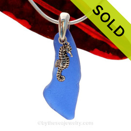 A long sliver of cobalt blue sea glass and seahorse charm on a solid sterling cast bail and presented on an 18 Inch solid sterling snake necklace chain. Sorry this Sea Glass Necklace has been SOLD!
