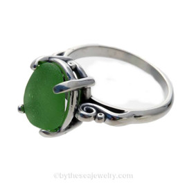 A natural UNALTERED pure bright rich green sea glass piece set in a sterling silver scroll ring. This is the EXACT sea glass ring you will receive