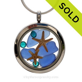A beautiful pieces of Genuine blue Sea Glass combined in a stainless steel locket necklace with two real starfish. Sorry this locket has been SOLD!