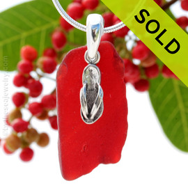 Not perfect but a large ruby red sea glass piece set on a solid sterling professionally handcast bail and finished with a flip flop charm! SOLD - Sorry This Sea Glass Jewelry Selection Is NO LONGER AVAILABLE!