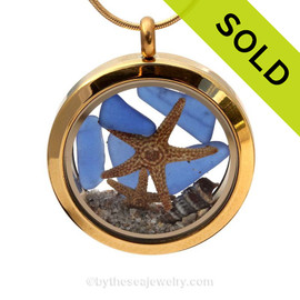A gold tone stainless steel locket necklace with real blue beach found sea glass pieces and two real starfish!