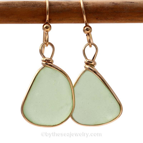 This is a larger pair of Genuine Sea Glass Earrings. Genuine beach found vivid yellowy sea green Sea Glass Earrings in a 14K Rolled Gold Original Wire Bezel setting.