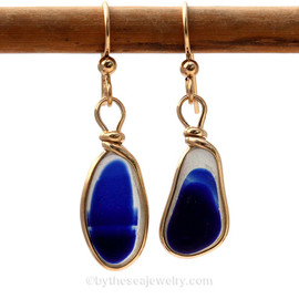 Vivid flashed blue English sea glass pieces set in our Original Wire Bezel© setting  This setting leaves the sea glass totally UNALTERED