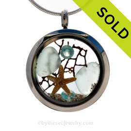 Genuine aqua sea glass combined with a vintage sea fan, vivid crystal aquamarine gems and a baby starfish in this stainless steel locket. SOLD - Sorry this Sea Glass Jewelry Selection is NO LONGER AVAILABLE!