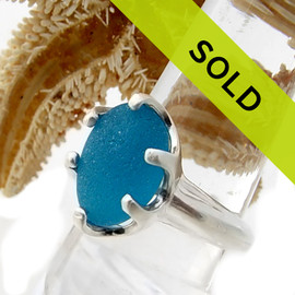 A once in a lifetime sea glass ring in an electric aqua beach found sea glass.