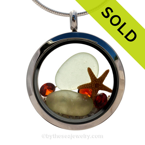 Beautiful pieces of soft Seafoam Green sea glass, a real starfish and bit of sea fan in a stainless steel locket combined with Crystal Garnet faceted gems. SOLD - Sorry This Sea Glass Jewelry Selection Is NO LONGER AVAILABLE!