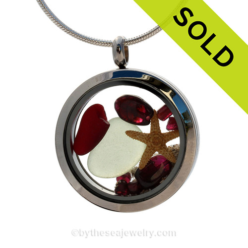A Beautiful piece of RARE Red beach found sea glass, a real starfish and round genuine garnet gems in a stainless steel locket combined with Crystal Garnet faceted gems.