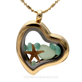 Beautiful pieces of seafoam and aqua sea glass pieces combined with a real starfish. Finished with a real Starfishy in this Goldtone Heart Locket Necklace. Comes with this goldtone bead chain which is adjustable from 22 to 20 Inches