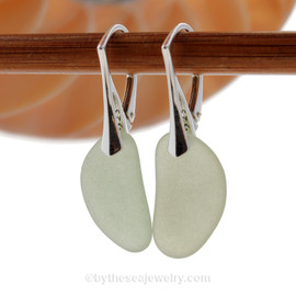Seafoam Green sea glass pieces on solid sterling silver leverbacks.