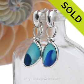 Super Ultra Mixed Cobalt Blue and Aqua sea glass pieces from Seaham England are set in our Original Wire Bezel© earring setting. This is a very hard sea glass to match as colors were randomly mixed together over 100 years ago. SOLD  - Sorry these Ultra Rare Sea Glass Earrings are no longer Available.