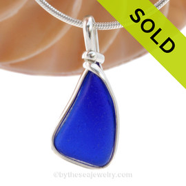 A smaller but thick piece of Cobalt Blue Genuine Sea Glass with in our signature Original Wire Bezel© pendant setting in Sterling Silver. SOLD - Sorry this Sea Glass Pendant is NO LONGER AVAILABLE!
