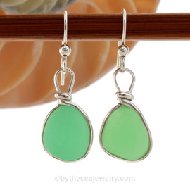 ULTRA RARE UV Vivid Jadeite Green Glowing Sea Glass Earrings set in our Original Wire Bezel ©2000 Setting lets all the beauty of these beauties shine! This setting does not alter the sea glass from the way it was found on the beach.