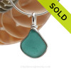 An incredible piece of Teal Green or Turquoise sea glass set for a necklace in our Original Sea Glass Bezel© in solid sterling silver setting. SOLD - Sorry this Rare Sea Glass Pendant is NO LONGER AVAILABLE!