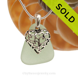 A  perfect piece of larger seafoam green  genuine sea glass with a solid sterling bail and detailed heart in hearts charm. SOLD - Sorry this Sea Glass Necklace is NO LONGER AVAILABLE!