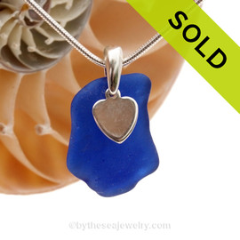 A nice piece of blue genuine sea glass with a solid sterling bail and simple heart charm. This piece comes complete with our sterling 1.3 MM snake chain.