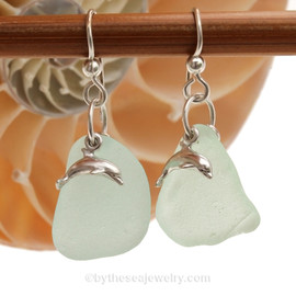 Large piece of seafoam green sea glass pieces set with LARGE sterling seahorse charms on sterling silver hook earrings.