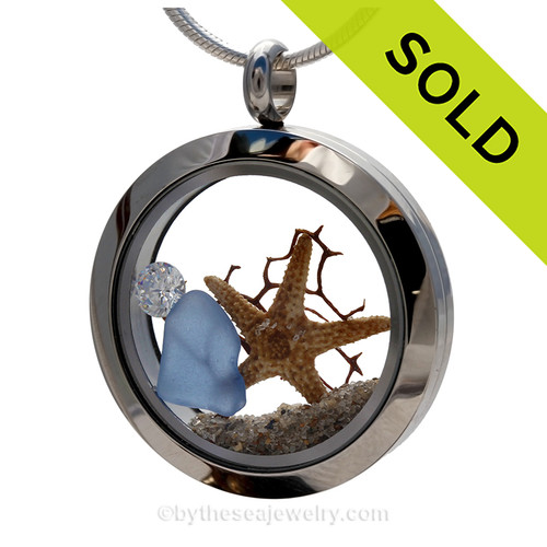 "A Beautiful Carolina Blue Genuine Sea Glass Locket with a real starfish. and beach sand, finished with a vivid brilliant cut CZ gem ""Diamond"" great for any April Beach Baby! SOLD - Sorry this Sea Glass Locket is NO LONGER AVAILABLE!"
