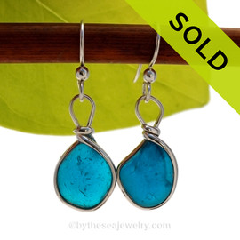SOLD - Sorry these Ultra Rare Sea Glass Earrings are NO LONGER AVAILABLE! SUPER Ultra Rare Mixed Electric Teal sea glass pieces from Seaham England are set in our Original Wire Bezel© earring setting. This is a very hard sea glass to match.