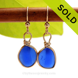 A beautiful vivid blue ridged sea glass pieces set in a gold bezel setting SOLD - Sorry these Rare Sea Glass Earrings are NO LONGER AVAILABLE!