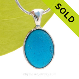 SOLD - Sorry this Ultra Rare Sea Glass Pendant is NO LONGER AVAILABLE ONCE-IN-A-LIFETIME Natural Sea Glass Electric Teal set in our deluxe wire bezel pendant setting!