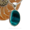 This rare Seaham mixed electric vivid teal sea glass multi color pendant is set in our Deluxe Wire Bezel© pendant setting.