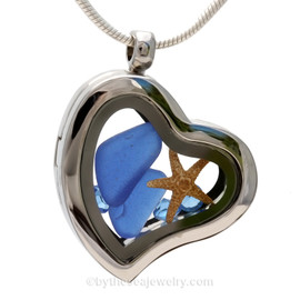 """Beautiful pieces cobalt blue sea glass pieces combined with a real starfish. Finished with Bright Blue Crystal gems in this Genuine Sea Glass Heart Locket Necklace. Comes with a Free PLATED 18 """" Chain (not shown)."""