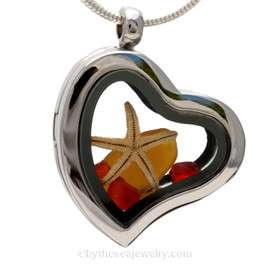 """Beautiful Amber sea glass pieces combined with a real starfish and red glass chips in this Genuine Sea Glass Heart Locket Necklace. Comes with a Free PLATED 18 """" Chain (not shown)."""