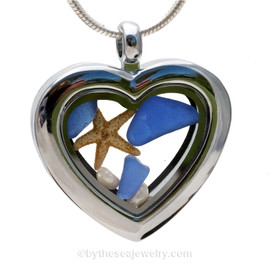 "Beautiful pieces cobalt blue sea glass pieces combined with a real starfish and tiny fresh water pearls in this Genuine Sea Glass Heart Locket Necklace. Comes with a Free PLATED 18 "" Chain (not shown)."