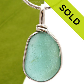A P-E-R-F-E-C-T piece of beach found glass from Seaham England in aqua is set in our Original Wire Bezel© pendant setting. SOLD - Sorry this Rare Sea Glass Pendant is NO LONGER AVAILABLE!