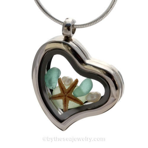 """Beautiful pieces of Seafoam Green sea glass pieces combined with a real starfish. Finished with genuine Fresh Water Pearls in this Genuine Sea Glass Heart Locket Necklace. Comes with a Free PLATED 18 """" Chain (not shown)."""