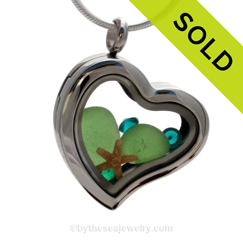 Beautiful pieces of Genuine Green Sea Glass combined with a Real Starfish. Finished with crystal gems in this heart locket. SOLD - Sorry this Sea Glass Locket is NO LONGER AVAILABLE!