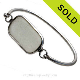 Genuine Sea Glass Bangle Bracelet set in our Deluxe Wire Bezel© sterling silver setting. SOLD - Sorry this Sea Glass Bangle Bracelet is NO LONGER AVAILABLE!