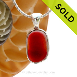 An awesome mixture of hot pink and gold fused inside this incredible sea glass piece from England. Set in sterling silver, this is a beautiful pendant for any necklace. SOLD - Sorry this Ultra Rare Sea Glass Pendant is NO LONGER AVAILABLE!