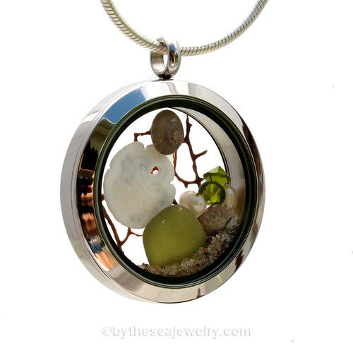 Genuine Seaweed Green sea glass pieces combined with a real baby sandollar, tiny nautilus shells, vintage seafan and genuine freshwater pearl sand real beach sand in this stainless steel locket.