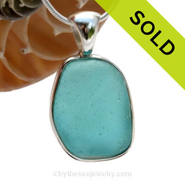 A LARGE and curvy piece of Vivid Electric Aqua Blue Genuine Sea Glass in our In Our Deluxe Sterling Wire Bezel© Necklace Pendant. SOLD - Sorry this Rare Sea Glass Pendant is NO LONGER AVAILABLE!