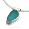 A stunning large aqua sea glass set in fine silver and sterling silver necklace tube slide. This piece comes on a thin solid sterling satin finished oval collar.