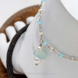 A simple white and aqua sea glass anklet with real pearls for your beach trips this summer. Great for beach brides too!